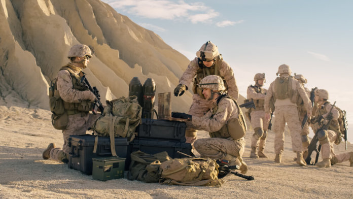 US Soldiers have a batteries